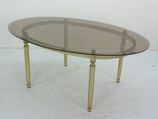 French Hollywood Regency Smoked Glass & Brass Oval Cocktail Table, 1970s