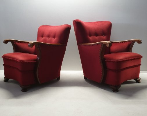 Pair of Art Deco oak wing back armchairs with red velvet upholstery