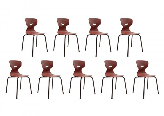 Set of nine industrial pagwood ergonomic resin plywood stacking chairs by Flötotto, 1960s