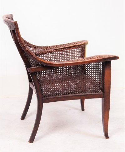 English signed rattan armchair