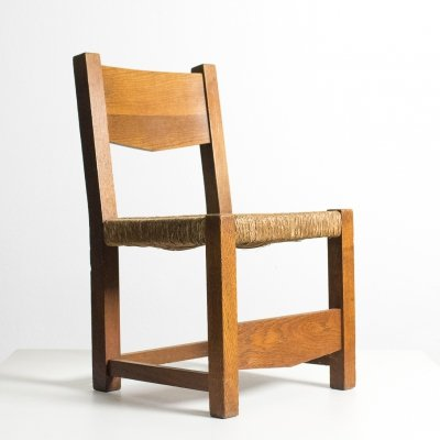 Early modernistic low chair in solid oak