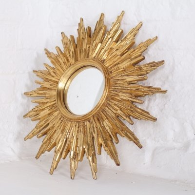 Gilt convex sunburst mirror by Deknudt, 1960s