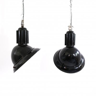 Two black enameled industrial hanging lamps