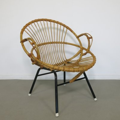 Small rattan chair with armrests by Rohé Noordwolde