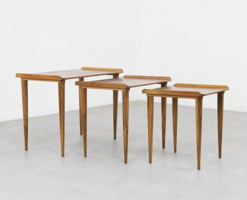 Italian nesting tables in bookmatched walnut, 1960s