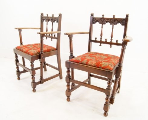 Pair of Ercol Oak Arm chairs, signed