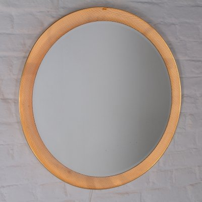 Illuminated circular preforated steel mirror