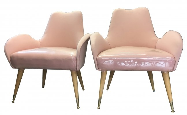 Pair of pink fabric armchairs with wooden feet & brass terminals, 1950's