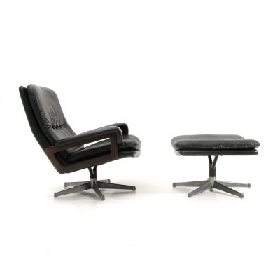 'King' Armchair with ottoman in black leather by André Vandenbeuck for Strässle, 1960s