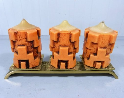 Bronze candle holder with the original orange sixties candles