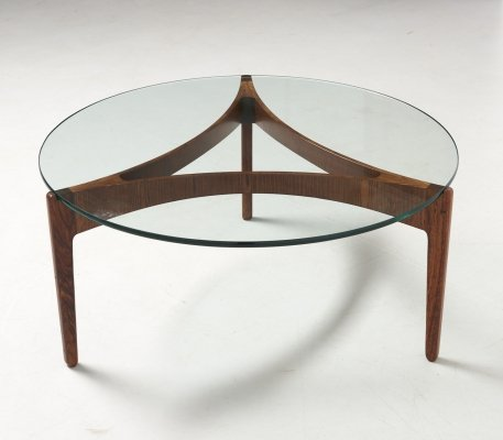 Round low table with glass table top with by Sven Ellekaer