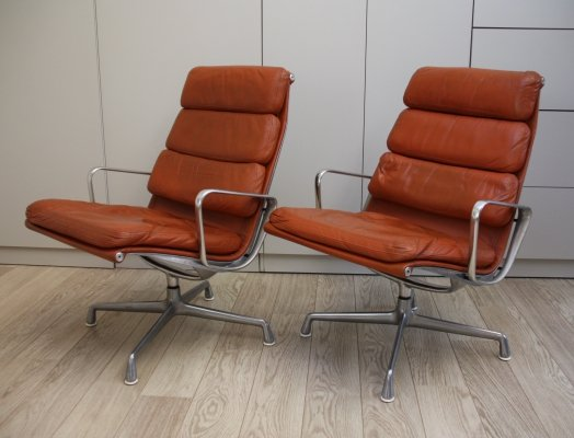 Set of 2 EA 116 'softpad' armchairs in cognac leather by Charles & Ray Eames for Herman Miller, 1970s