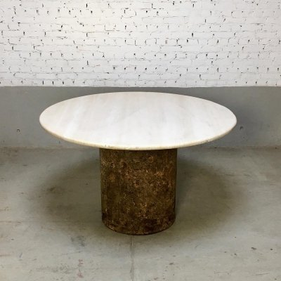 Travertine dining table with cork base