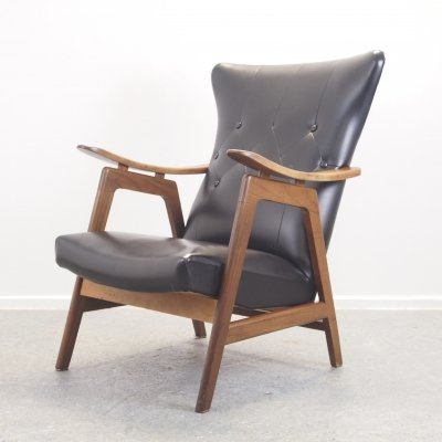 Vintage mid century teak lounge chair with black padded leatherette upholstery