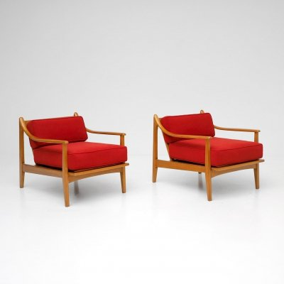 Pair of rare easy chairs made with rattan details & red fabric cushions