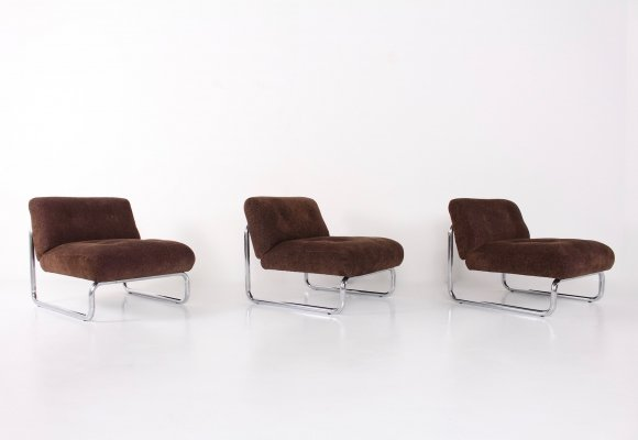 3 brown velvet easy chairs with tubular chromed structure