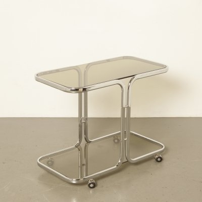Drinks cart on wheels in chrome tube & smoked glass