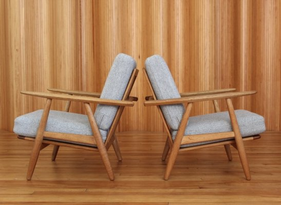 Pair of Hans Wegner oak GE240 'cigar' lounge chairs by Getama Denmark