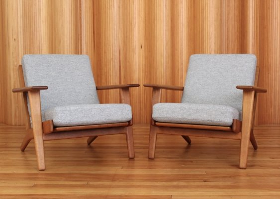 Pair of Hans Wegner oak GE290 'plank' lounge chairs by Getama Denmark