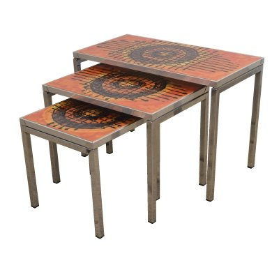 3 ceramic nesting tables with a chromed metal frame