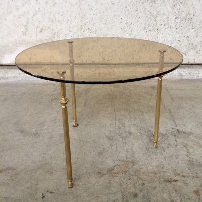 Hollywood Regency round smoke glass side table with tripod legs, 1960s