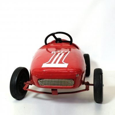 Red child's race car from the 1950s-1960s