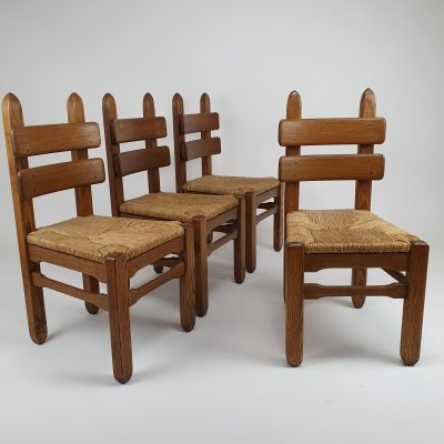Set of 4 Brutalist Sculptural Oak & straw dining chairs, 1950s