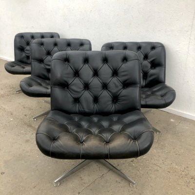 Set of 4 Vintage black leather lounge swivel chairs, 1960s