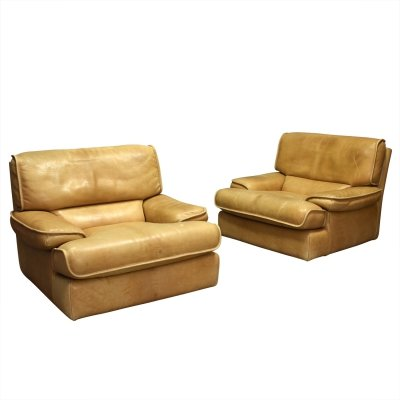 Pair of cognac leather club lounge chairs, 1970's