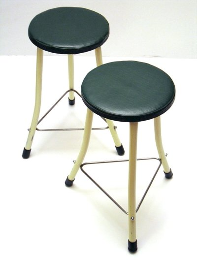 Two dark green metal fifties Brabantia stools