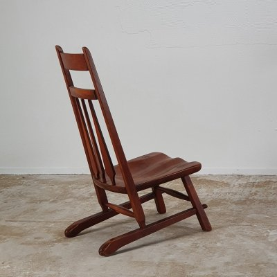 Sculptural low chair in solid wood, 1940s