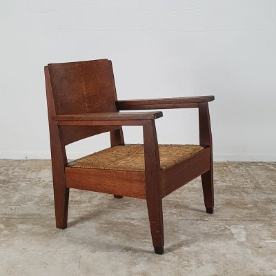 1920s low chair with wicker seating