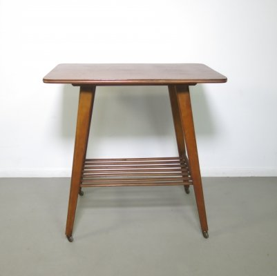 Teak side table with small wheels, ca 1960