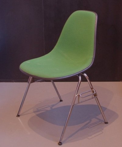 Charles & Ray Eames Black Fiberglass chair with Green upholstery