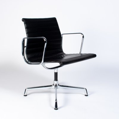 Black Leather & Chrome 'ea107' arm chair by Charles & Ray Eames for Vitra, 1990's