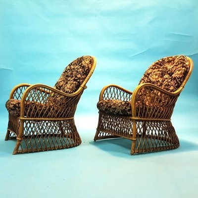 Mid century bohemian lounge chairs in rattan & floral upholstery