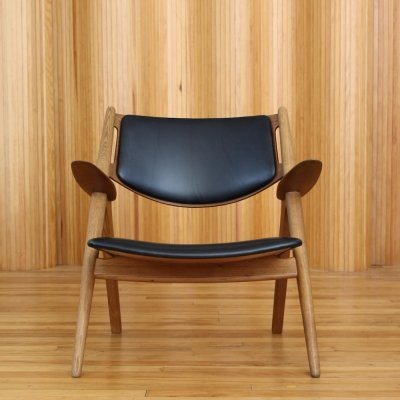 Hans Wegner model CH28 'Sawbuck' / 'Sawhorse' lounge chair by Carl Hansen & Son