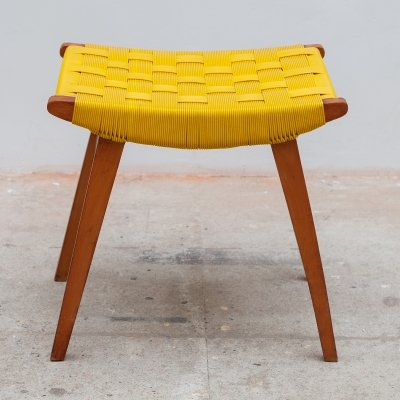 Stylish beech frame stool with durable woven plastic seat in a bright yellow