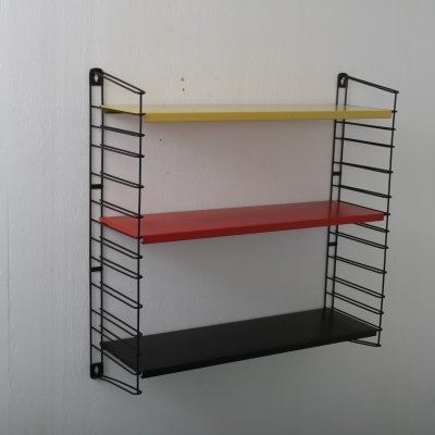 Colorful book rack designed A. Dekker for Tomado, 1950s