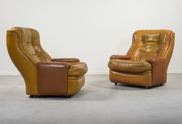 Cognac leather armchairs by Michel Cadestin for Airborne, 1960's