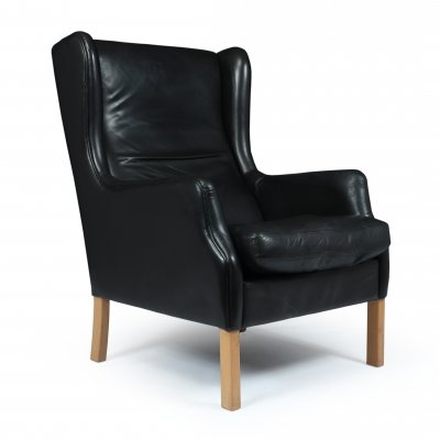 Mid Century Danish Black Leather Wing Chair by Georg Thams