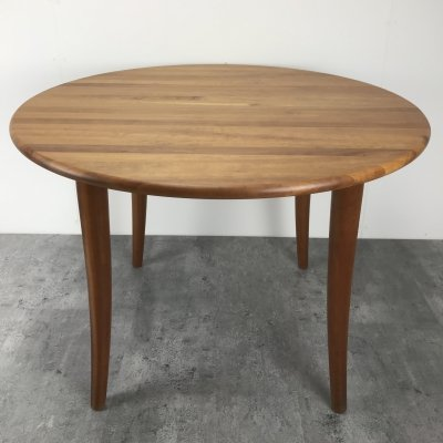 Round teak Danish dining table with 4 tapered legs