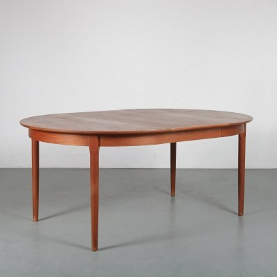Round extendable dining table by A.R. Denmark, 1950s