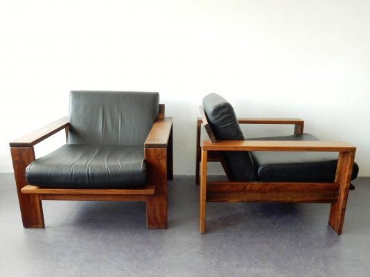 Lounge chair in solid wood with faux leather cushions