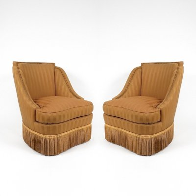 Pair of fringe lounge chairs, 1940s