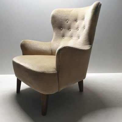 Mid-century velvet wingback lounge chair by Theo Ruth for Artifort, 1950s
