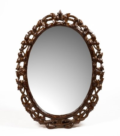 Large solid wood mirror carved with foliage, 1920s