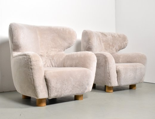 Pair of luxury French lounge chairs in real sheepskin, 1920s