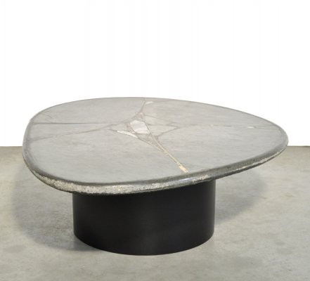 Brutalist oval natural stone coffee table by sculptor Paul Kingma, 1990s