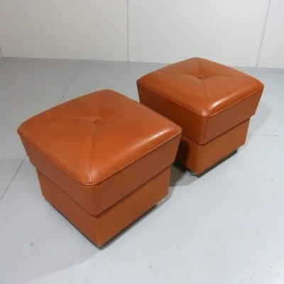 Set of 2 leather poufs on wheels, 1960's